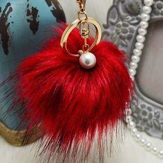 Red Faux Fox Fur pom pom keychain with pearl NWOT! Brand new!! Faux fox fur but really soft and great quality. Gold hardware.  Size: (approx) Ball Diameter = 8cm  Its a keychain, you can also use it to put as purse charm or just to hold any key.  Great gift for your family, friends or your self.  ** color might be slightly different cause of the lightning  Great for your Louis Vuitton, Prada, Fendi, Chanel, Michael Kors, Gucci, Coach Tory Burch, Kate spade, Marc jacobs and others…