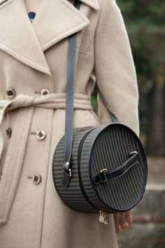 Vintage Fendi hat box bag, from 1970,adds retro cool to a classic coat.Retro Inspired Streetstyle.