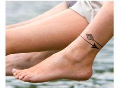 10 Amazing Ankle Arrow Tattoo Designs - http://www.allnewhairstyles.com/10-amazing-ankle-arrow-tattoo-designs.html