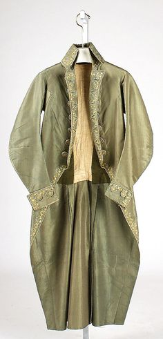 Formal coat, probably France, c. 1792. Pale green silk embroidered with coloured silks in a floral pattern along the fronts, collar and cuffs and pocket flaps, back vent and pleats.