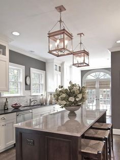 Bright and open. Love the lanterns. Layout it great. Pantry or laundry by the door. Don't like cabinets.