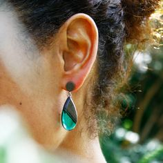 Our tear drop greywood earrings with emerald green resin