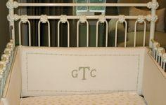 LOVE the monogram bumper and antique iron crib!!