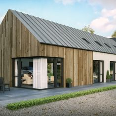 A modern house in Straffan, County Kildare to suit a (growing) young family. featuring timber cladding and zinc roof with open plan living. Wooden Cladding Exterior, Roof Cladding, House Cladding, Wooden Facade, Timber Cladding, Facade House, Stone Cladding, Cladding Ideas, Modern Roof Design