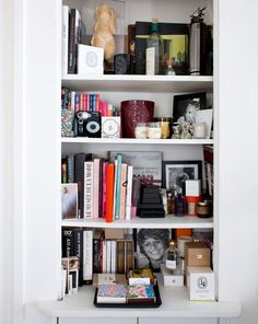 Charlotte, Paris 7ème - Inside Closet. I love people's bookshelves, they are like a biography: the books they read, the things they collect, personal photos, etc