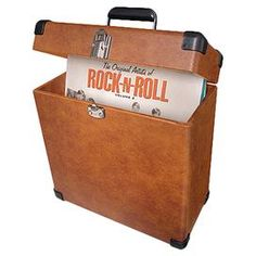 """Record carrying case. Can hold more than thirty albums.   Product: Record caseConstruction Material: Metal, resin and vinylColor: TanFeatures:  Holds 30+ albumsChrome snap closureCorner guards  Durable hardware Dimensions: 14.25"""" H x 13.75"""" W x 6.75"""" D 43"""