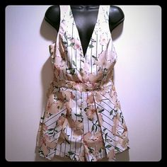 One piece open back floral with stripes romper Perfect for that vacation to the islands or beachside, this romper is chic and perfect for summer. Black and white stripes pull in a classy touch to the beige and light pink flowers. No paypal. No modeling. No trades. Price is firm unless bundling. Will ship the same or next day. Comes from a pet and smoke free home. Jealous Tomato Other