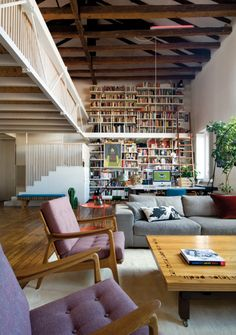 The chairs, the wall of books, a room for reading with good light, high ceilings with wooden beams, loft, and a tree.  Favorite!