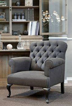 Grey chair with blue grey walls