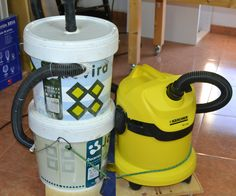 This is my homemade vacuum cyclone system. It consits of two empty paint buckets and some vacuum hoses. Most of the sawdust and particles stay in the buckets and...