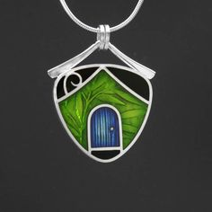 PMC, sterling silver and resin pendant. $175.00, via Etsy.