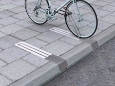 bike parking What a smart, innovative bike rack. The idea was to design bike parking that wouldn't an obstacle when it is not pinned to it a bike. Smart Design, Clever Design, Cool Designs, Urban Furniture, Street Furniture, Luxury Furniture, Furniture Buyers, Furniture Cleaning, Furniture Nyc
