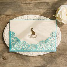 https://www.elegantweddinginvites.com/product/elegant-tiffany-blue-laser-cut-pocket-foil-bride-and-groom-weding-invitations-ewws123/