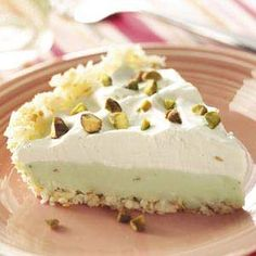 Coconut Pistachio Pie with coconut crust - 2-1/2 cups flaked coconut, lightly toasted, 1/3 cup butter, melted 2 cups cold 2% milk, 2 packages (3.4 ounces each) instant pistachio pudding mix, 1 cup whipped topping