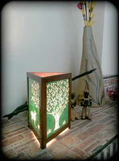 An exotic driftwood, a  beautiful Sanjhi Teak Lamp and Terracotta vases are perfect way to decorate your fireplace