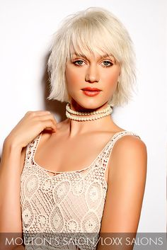 This blunt bob with jagged layers that skim the eyes and frame the face is amplified with a white-hot blonde that strengthens the overall look.