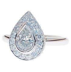 I love this ring, I admire it all the time. PEAR SHAPE DIAMOND ENGAGEMENT RING | Stephen Dibb Jewellery
