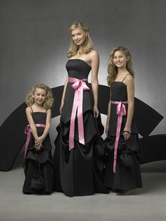 These look very similar to your dress.. if we can find in your colors.. maybe purple with a teal bow? About Beauty, Face and Fashion   like mother, like daughters   The Jewelry Hut Princess Parlor Bridal and Bridesmaid Fashion   Pretty queen and princesses in black gown with pink accent   #thejewelryhut