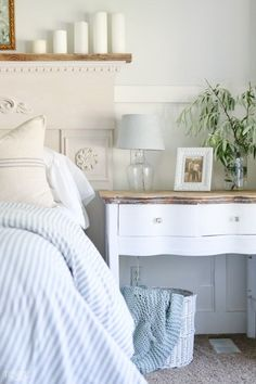 White Trim and woodworking is Super White by Benjamin Moore. Soft blue/gray walls is Willow Springs by PPG Paints