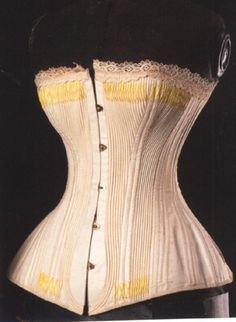 """1875-1885 french corded corset with yellow flossing (waist 21"""" bust 27"""")"""