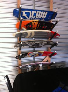 Wakeboard wall racks wakeboarding wakeboard racks for Boat garage on water