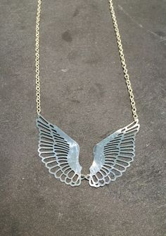 Collier ailes en acier inoxydable
