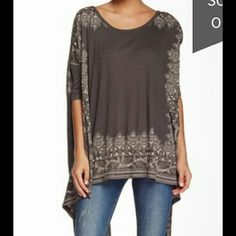 Free People Absolutely beautiful .Dolman pick me up tee. Color is in night combo . Brand new with tags Free People Tops Tees - Long Sleeve