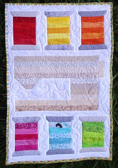 Sweet Spools Mini Quilt.  Would make a great sewing room wall hanging.  Peace, Robert from nancysfabrics.com