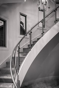 Elegant curved stair with innovative glass treads.