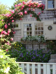 Nantucket Style Chic Design Inspiration & House Exteriors Climbing blooms on a Nantucket cottage with flower box. COME TOUR MORE Nantucket Style Chic & Summer Vibes! Nantucket Cottage, Nantucket Style, Beach Cottage Style, Cozy Cottage, Coastal Cottage, Cottage Homes, Coastal Style, Beach House, Nantucket Island