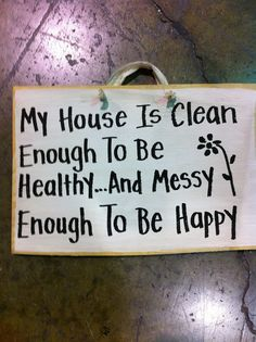 My house is clean enough to b healthy and messy enough to be happy sign. $9.99, via Etsy.