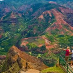 """Waimea Canyon, on Kauai's West Side, is described as """"The Grand Canyon of the Pacific."""" Although not as big or as old as its Arizona cousin, you won't encounter anything like this geological wonder in Hawaii. Stretching 14 miles long, one mile wide and more than 3,600 feet deep, the Waimea Canyon Lookout provides panoramic views of crested buttes, rugged crags and deep valley gorges. The grand inland vistas go on for miles."""