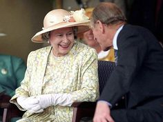 1995~ During a visit to Durban, South Africa, in the mid-1980s, the Queen and Prince Phillip share a laugh.