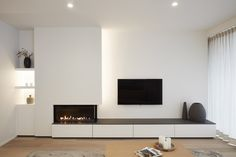 Lounge room cabinets for TV near fireplace