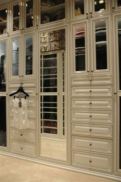 gorgeous custom dressing room cabinetry w/mirrors, drawers, doors & shelving