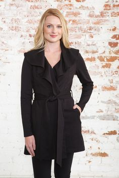 Exquisitely draped wrap coat features a flouncy, adjustable shawl collar and impeccable back detailing rife with pin-tucks and pleats! Self-belt can be tied to the front or back for added versatility.