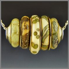 a stacked bead pendant focal ivory glass with silver & brass handmade lampwork sterling silver cored - Tullio