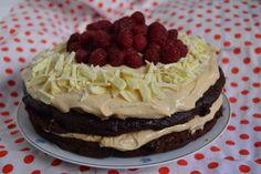 Шоколадова торта с чийз крем с дулсе де лече и малини