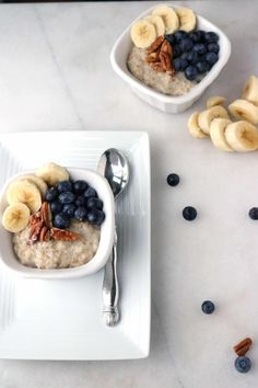 Instant Pot steel cut oatmeal served in a white dish and topped with blueberries, sliced banana, and pecans