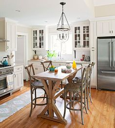 One-of-a-Kind Island Instead of a standard rectangular island, try a stand-alone table to create a cozy feel. Chairs can be pulled up for a casual meal or pushed to the side for meal prep and serving.