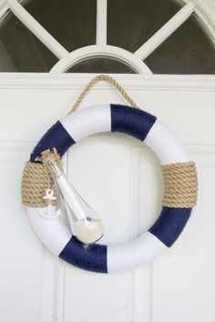 Turn your home into a beach house, even though it may be hundreds of miles away from the nearest beach, with this DIY nautical wreath! Coastal Wreath, Nautical Wreath, Seashell Wreath, Seashell Crafts, Nautical Theme, Nautical Craft, Nautical Quotes, Nautical Logo, Beach Wreaths