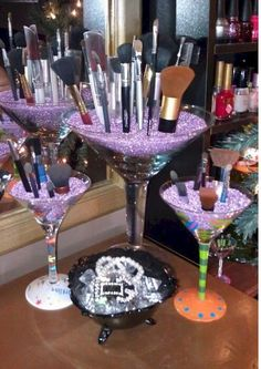 Wine glass makeup brush holder with beads…love this in my vanity room. Wine glass makeup brush holder with beads…love this in my vanity room.