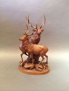 Circa:  1890 This magnificent Swiss Black Forest carving captures the grandeur of a stag group. The fine details etched into walnut capture the movement and captivating stature of these legendary creatures.