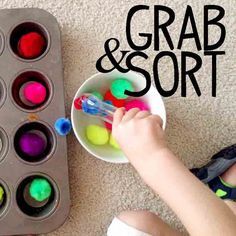 A fun and easy toddler activity that can be set up in seconds. Let your toddler grab and sort pom pom balls for loads of fine motor skills fun