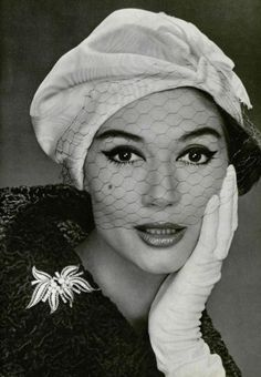 Simone D'Aillencourt in hat by Lanvin-Castillo and brooch by Mauboussin, 1958 photo by Phillipe Pottier.