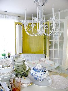 oh my gosh...dream home for sure...I love all of the white with the hints of glamour and charm