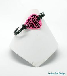 Guitar Pick Bracelet Pink Black Graffiti Black Leather Cord. $20.00, via Etsy.