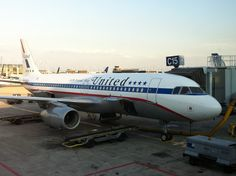 A retro United Airlines Friendship livery jet, parked at Chicago O'Hare.