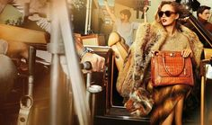Michael Kors - Hustle and bustle all around her, but she's calm, cool, collected, and looking fabulous. She is the focal point, and she knows it. #fashion #ad #michaelkors