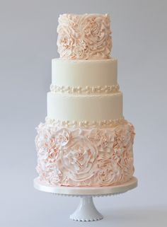 Warm pink and white buttercream wedding cake with ruffled tiers contrasting plain white tiers. A beautiful buttercream wedding cake!